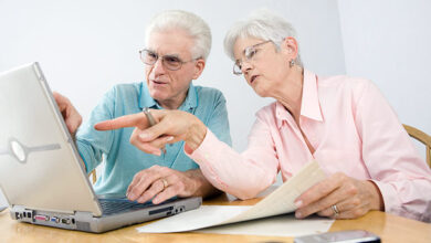 Image of an older couple looking at a laptop